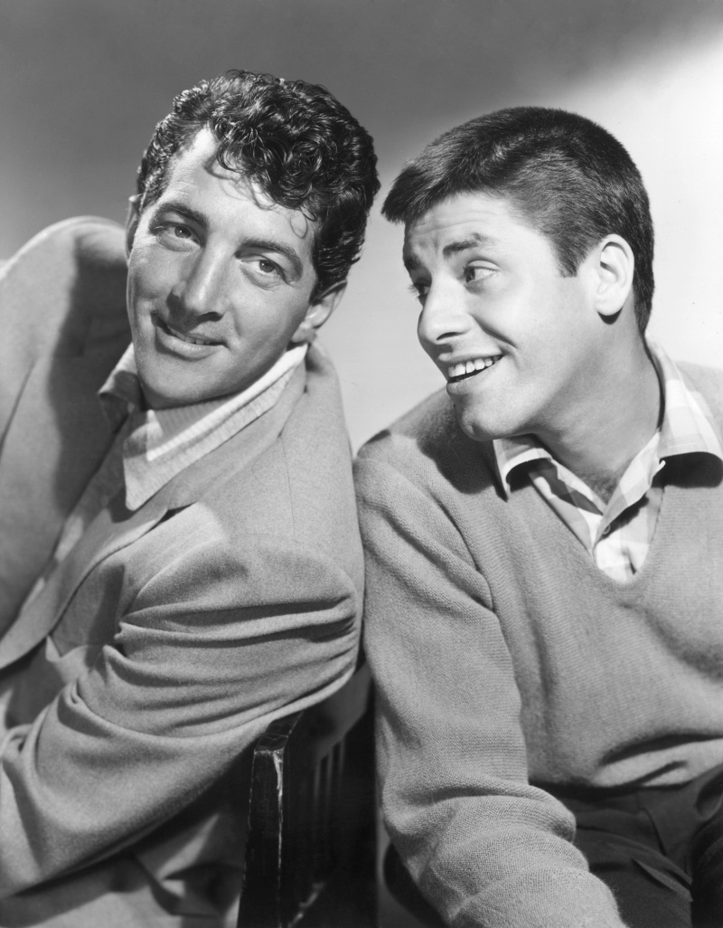 1953: American comic team Dean Martin (L) and Jerry Lewis smiling, in a promotional portrait for the television show, 'The Colgate Comedy Hour,' of which they were frequent hosts.